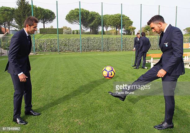 Senad Lulic and Danilo Cataldi play with the ball wearing the official uniform during the SS Lazio training session at Formello Sport Center on...