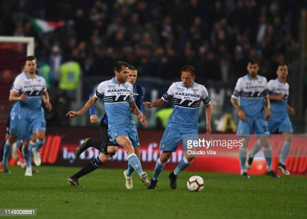 Senad Lulic and Lucas Leiva of SS Lazio control the ball during the TIM Cup Final match between Atalanta BC and SS Lazio at Stadio Olimpico on May 15...