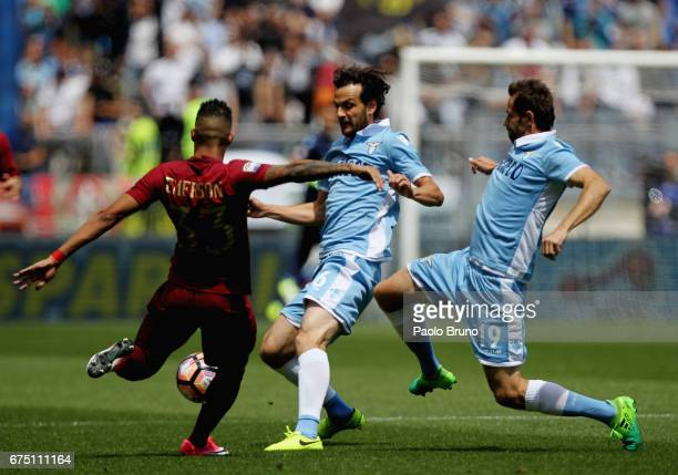 Senad Lulic and Marco Parolo of SS Lazio compete for the ball with Emerson Palmieri of AS Roma during the Serie A match between AS Roma and SS Lazio...