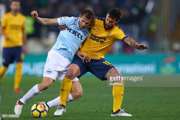 Senad Lulic of Lazio and Antonio Caracciolo of Verona at Olimpico Stadium in Rome Italy on February 19 2018