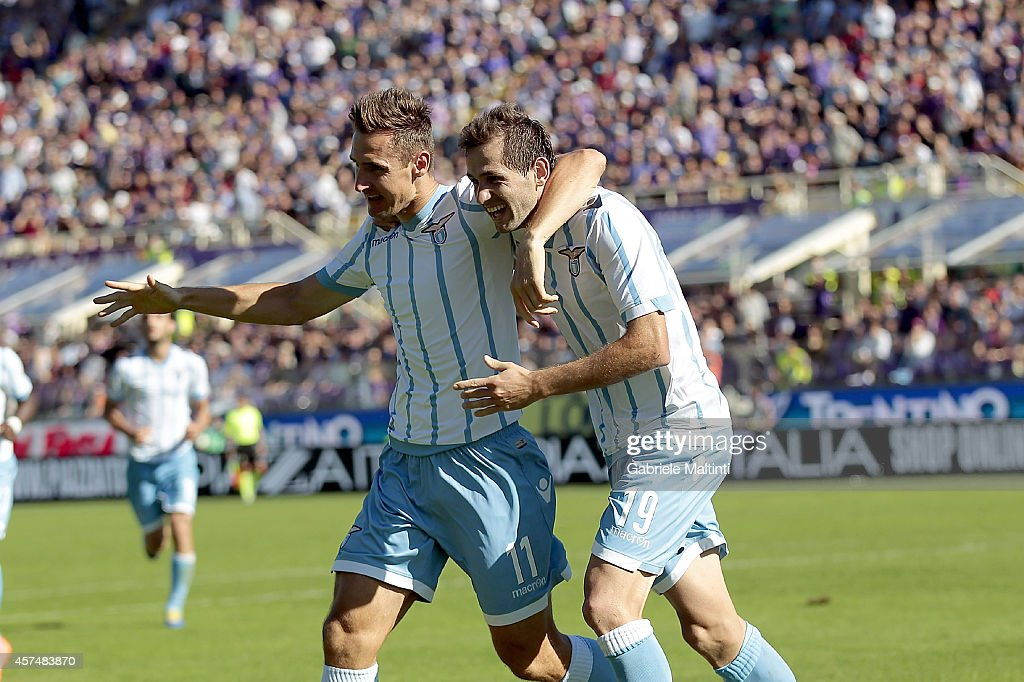 Senad Lulic (R) of SS Lazio celebrates after scoring a goal during the Serie A match between ACF Fiorentina and SS Lazio at Stadio Artemio Franchi on October 19, 2014 in Florence, Italy.