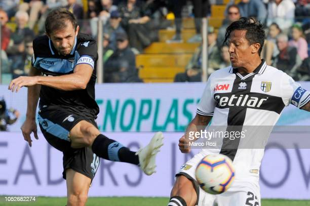 Senad Lulic of SS Lazio compete for the ball with Bruno Alves of Parma Calcio during the Serie A match between Parma Calcio and SS Lazio at Stadio...