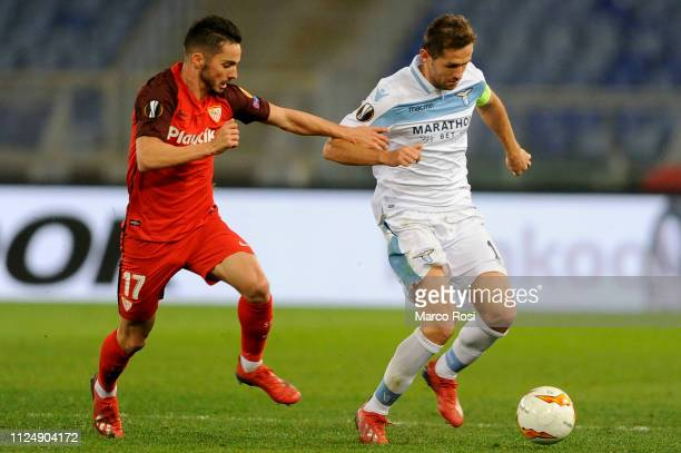 Senad Lulic of SS Lazio compete for the ball with Ever Banega of Sevilla during the UEFA Europa League Round of 32 First Leg match between SS Lazio...