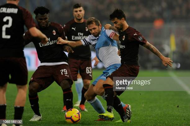 Senad Lulic of SS Lazio compete for the ball with Jesus Joaquin Fernandez Suso and Franck Kessieof AC MIlan during the Serie A match between SS Lazio...