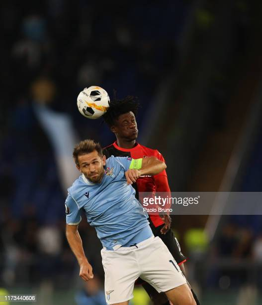 Senad Lulic of SS Lazio competes for the ball with Eduardo Camavinga of Stade Rennes during the UEFA Europa League group E match between SS Lazio and...