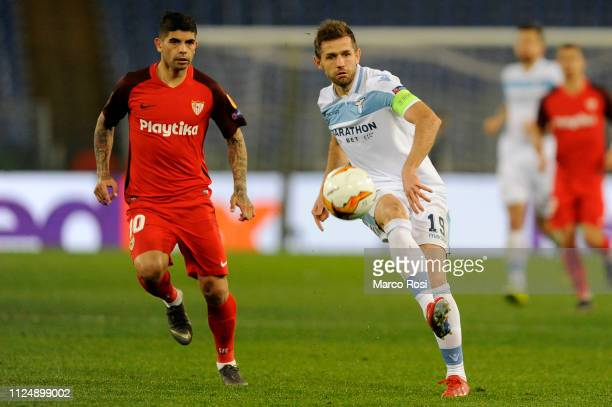 Senad Lulic of SS Lazio competes for the ball with Ever Banega of Sevilla during the UEFA Europa League Round of 32 First Leg match between SS Lazio...