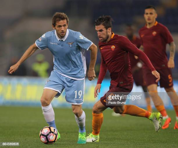 Senad Lulic of SS lazio competes for the ball with Kevin Strootman of AS Roma during the TIM Cup match between AS Roma and SS Lazio at Stadio...