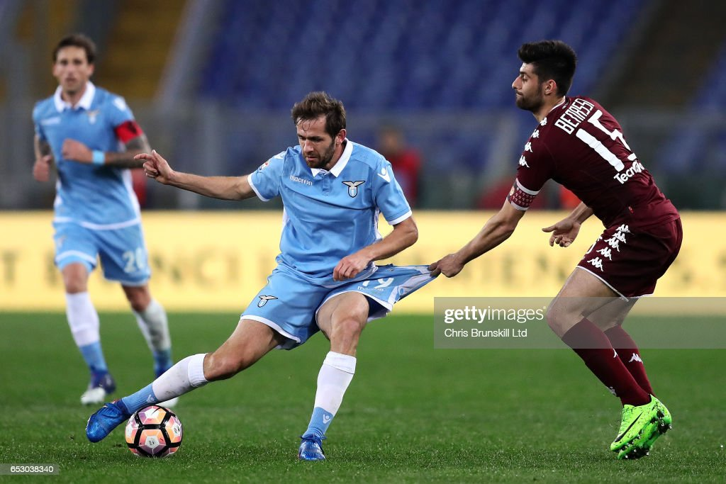 Senad Lulic of SS Lazio is fouled by Marco Bernassi of FC Torino during the Serie A match between SS Lazio and FC Torino at Stadio Olimpico on March 13, 2017 in Rome, Italy.