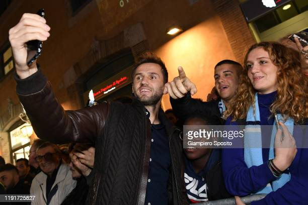 Senad Lulic of SS Lazio poses for a selfie with supporters as he attends the SS Lazio store opening ceremony on December 03 2019 in Rome Italy