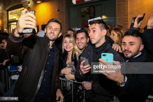 Senad Lulic of SS Lazio poses for a selfie with supporters during the SS Lazio Store Opening ceremony on December 03 2019 in Rome Italy