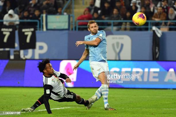 Senad Lulic of SS Lazio scores the goal of 12 during the Italian Supercup match between Juventus and SS Lazio at King Saud University Stadium on...