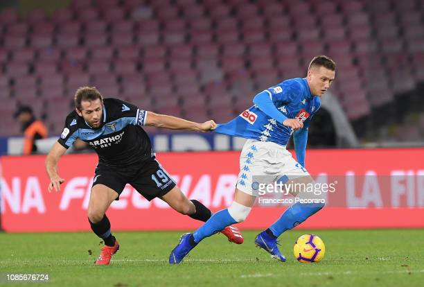 Senad Lulic of SS Lazio vies Piotr Zielinski of SSC Napoli during the Serie A match between SSC Napoli and SS Lazio at Stadio San Paolo on January 20...