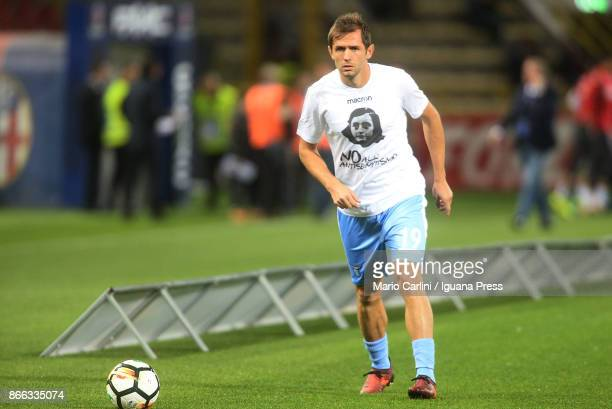 Senad Lulic of SS Lazio wears a shirt depicting Anne Frank saying 'no to antiSemitism' in response to antisemitic graffiti left by their fans at a...