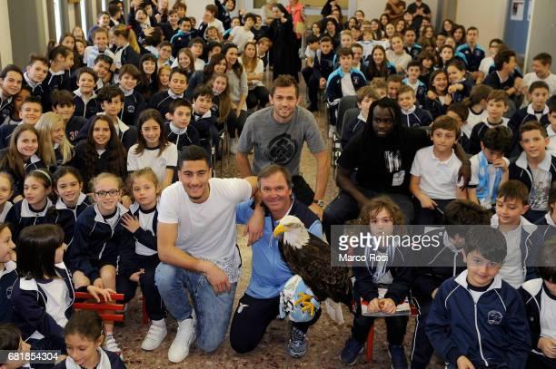 Senas Lulic Thomas Strakoscha and Jordan Lukaku of SS Lazio meet students at the San Giuseppe Caburlotto school on May 11 2017 in Rome Italy