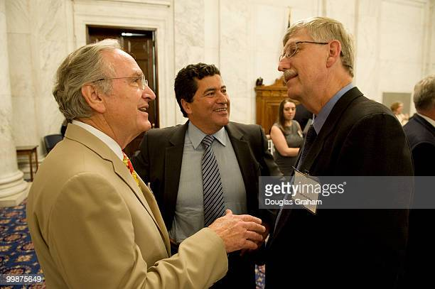 Senate Agriculture Chairman Tom Harkin DIowa talks with Dr Francis Collins right designated NIH director and Dr Elias Zerhouni former NIH director...