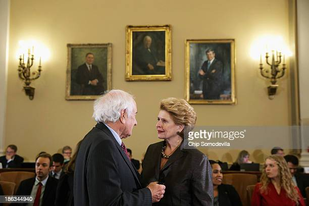 Senate Agriculture Nutrition and Forestry Committee Chairwoman Debbie Stabenow talks with US Rep Sandy Levin before the start of a conference...