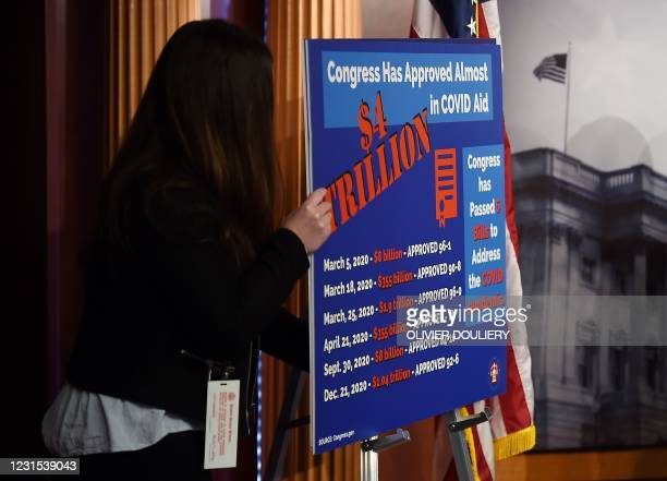 Senate aide displays a sign with talking points during a news conference given by Senator Lindsey Graham as the Senate continues to debate the latest...