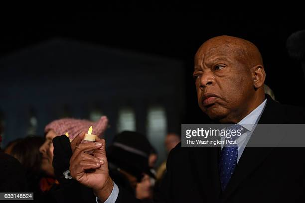 Senate and House Democrats, including Congressman John Lewis of Georgia, gathered on the steps of the US Capitol to demand the President withdraw the...