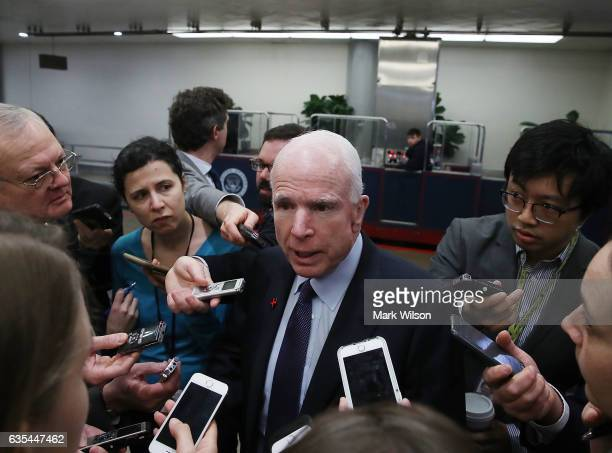 Senate Armed Services Committee Chairman John McCain fields questions from reporters on the resignation of National Security Adviser Michael Flynn...