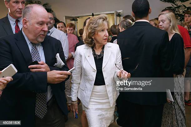 Senate Armed Services Committee Member US Sen Kay Hagan is pursued by reporters after being briefed by military officals about the prisoner exchange...