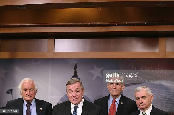 Senate Assistant Minority Leader Dick Durbin speaks while flanked by House Ways and Means ranking member US Rep Sander Levin Senate Armed Services...