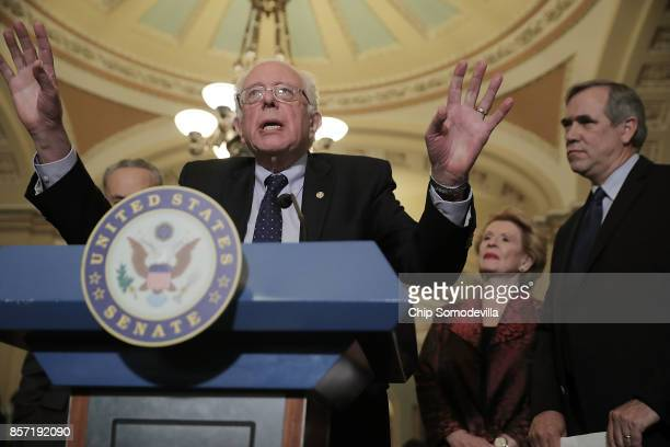 Senate Budget Committee ranking member Sen Bernie Sanders and fellow committee members Sen Debbie Stabenow and Sen Jeff Merkley speak to reporters...