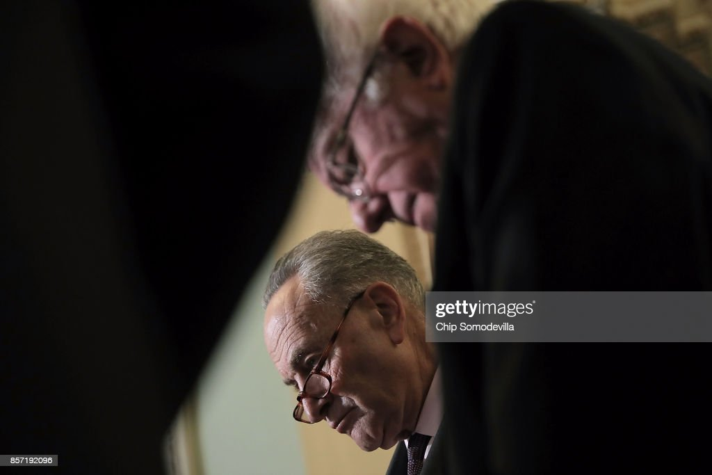 Senate Budget Committee ranking member Sen. Bernie Sanders (I-VT) (top) and Senate Minority Leader Charles Schumer (D-NY) speak to reporters following the weekly Senate Democratic policy luncheon at the U.S. Capitol October 3, 2017 in Washington, DC. Sanders and Schumer were both critical of the proposed Republican tax reform plan.