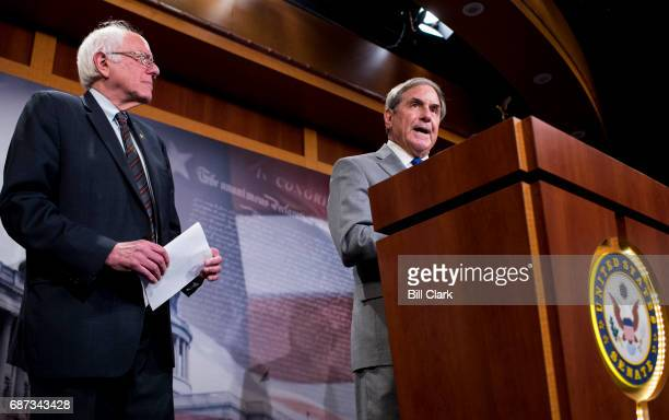 Senate Budget ranking member Bernie Sanders IVt left listens as House Budget ranking member John Yarmuth DKy speaks during the news conference to...