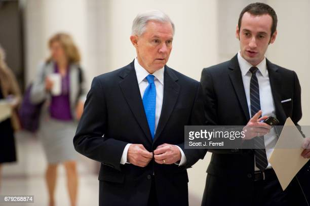 Senate Budget ranking member Jeff Sessions RAla arrives with his aide Stephen Miller for a news conference April 5 with House Budget Chairman Paul D...