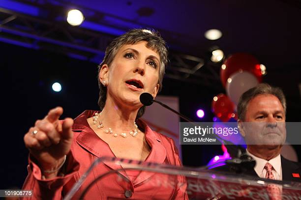 Senate candidate and former HewlettPackard CEO Carly Fiorina celebrates her primary win with her husband Frank Fiorina at her side at the California...