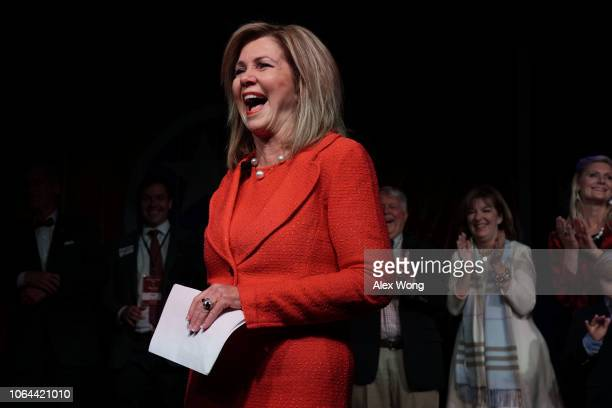 S Senate candidate for Tennessee Rep Marsha Blackburn rejoices as members of her family look on during an election night party November 6 2018 in...