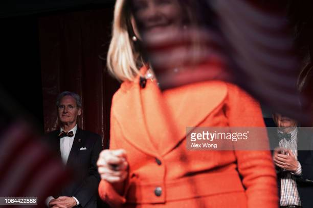 S Senate candidate for Tennessee Rep Marsha Blackburn speaks to supporters as her husband Chuck Blackburn looks on during an election night party...