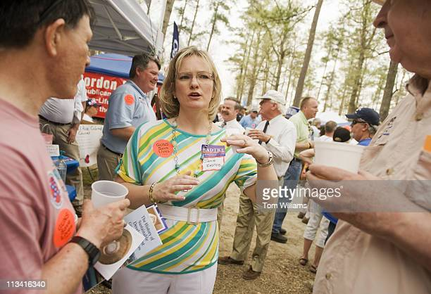 Senate candidate Jamie Radtke, R-Va., talks with attendees of the 63rd Annual Shad Planking political rally in Wakefield, Va. Gov. Bob McDonnell,...