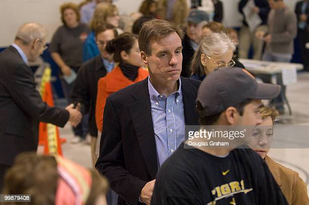 S Senate candidate Mark Warner waits in line to vote on November 4th 2008 at Lyles Crouch School in Alexandria Virginia He was accompanied by his...