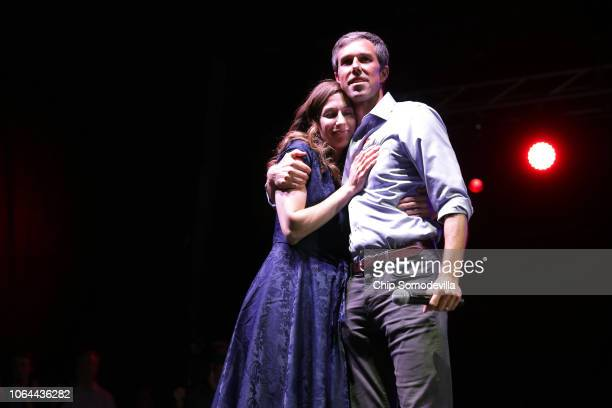 S Senate candidate Rep Beto O'Rourke and his wife Amy Sanders embrace while addressing supporters during a 'thank you' party on Election Day at...