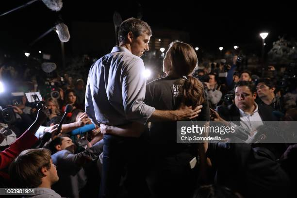 S Senate candidate Rep Beto O'Rourke and his wife Amy Sanders talk to journalists before a rally in the Magoffin Auditorium on the campus of the...