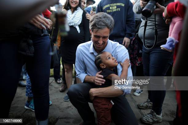 S Senate candidate Rep Beto O'Rourke embraces a child during a campaign rally at Opportunity Park November 2 2018 in Dallas Texas As Election Day...