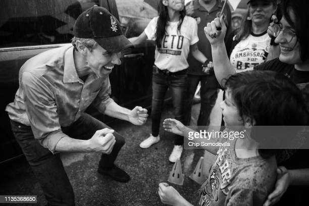 S Senate candidate Rep Beto O'Rourke greets a young supporter while taking photos with supporters during a campaign rally at Gilbert Garza Park...