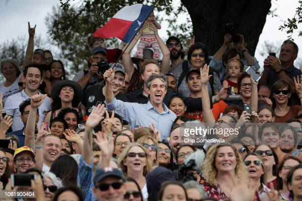 S Senate candidate Rep Beto O'Rourke holds a Texas flag as he poses for a group photo with supporters during a campaign rally in Mueller Lake Park...