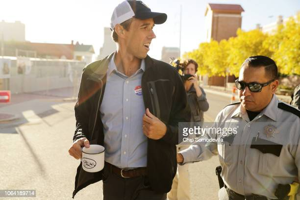 S Senate candidate Rep Beto O'Rourke is escorted by law enforcement after casting his ballot at El Paso Community CollegeRio Grande Campus on...
