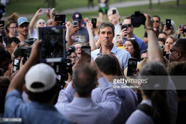 S Senate candidate Rep Beto O'Rourke is surrounded by supporters as he gives a speech during a campaign stop at Moody Park October 30 2018 in Houston...