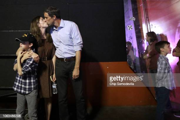 S Senate candidate Rep Beto O'Rourke kisses his wife Amy Sanders as they and their son Ulysses O'Rourke wait back stage before Beto addresses a...