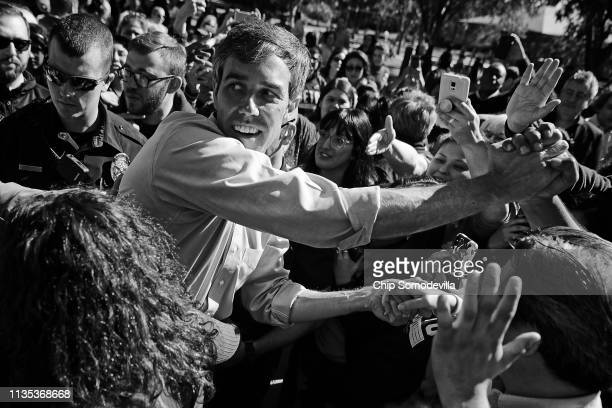 S Senate candidate Rep Beto O'Rourke shakes hands with supporters during a campaign rally at Harvest Run Park November 2 2018 in Carrollton Texas As...