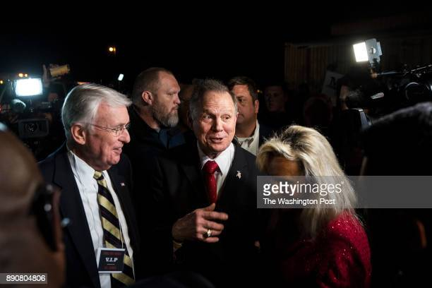 Senate candidate Roy Moore with his wife Kayla Moore by his side departs after speaking at a 'Drain the Swamp' campaign rally at Jordan's Activity...