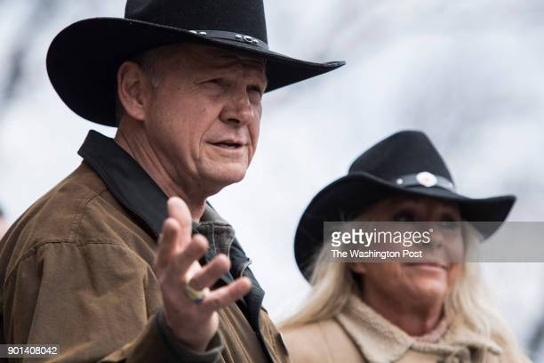 Senate candidate Roy Moore with his wife Kayla Moore talk to members of the media after voting and arriving by horse at the Gallant Volunteer Fire...