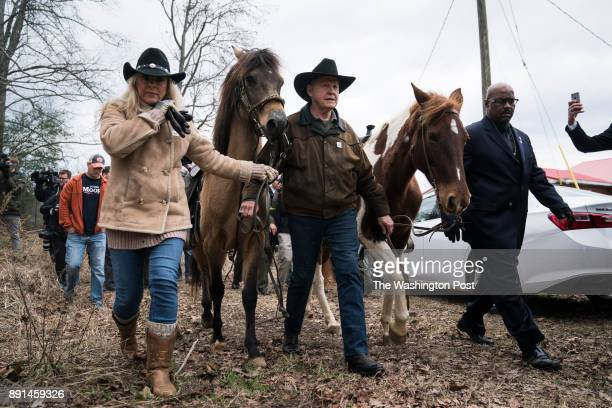 Senate candidate Roy Moore with his wife Kayla Moore walk off with their horses after voting at the Gallant Volunteer Fire Department in Gallant Ala...