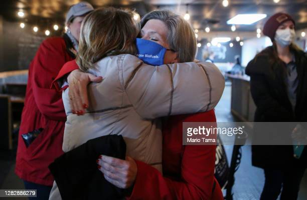 Senate candidate Sen. Joni Ernst ,C, hugs a supporter at a campaign event at Big Al's BBQ restaurant during her 'Fighting for Iowa' RV Tour on...
