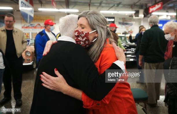 Senate candidate Sen. Joni Ernst , C, hugs a supporter at a campaign event at Dahl Auto Museum as part of her RV tour of Iowa on October 31, 2020 in...