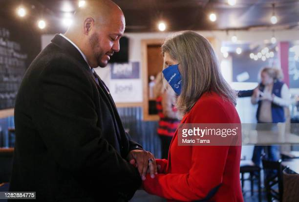 Senate candidate Sen. Joni Ernst , R, prays with Ian Alfonso Rojas after speaking to supporters at Big Al's BBQ restaurant during her 'Fighting for...