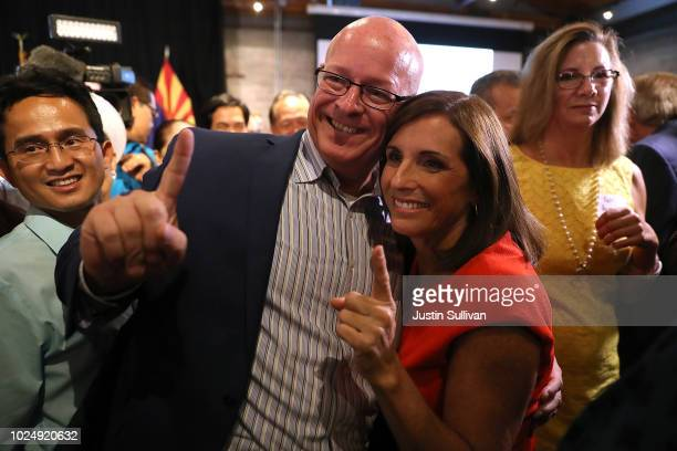 S Senate candidate US Rep Martha McSally takes a photo with a supporter during her primary election night gathering at Culinary Drop Out at The Yard...